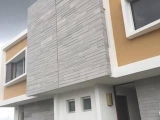 Casas pequeñas de estilo  por UG ARQUITECTOS