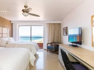 Hotel Westin Los Cabos : Recámaras de estilo  por Punto Cero ,