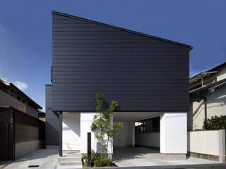 Casas de estilo ecléctico de プラスアトリエ一級建築士事務所 Ecléctico
