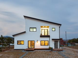 Wooden houses by 한글주택(주), Modern