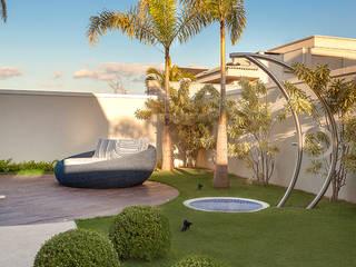 Modern Houses by Designer de Interiores e Paisagista Iara Kílaris Modern