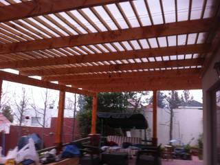 Terrazas, Quinchos JORGE PALMA PAPIC E.I.R.L. Balcones y terrazas rústicos