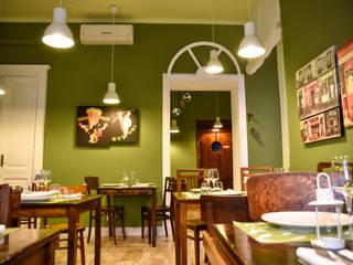 Ristorante in verde oliva: Negozi & Locali commerciali in stile  di Arch. Sara Pizzo - Studio 1881, Eclettico