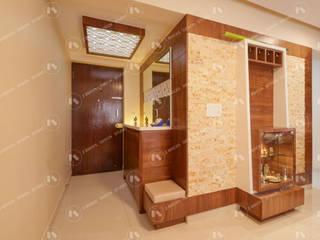 Apartment Interiors for Deepa and Prakash:  Living room by 2 Bricks Design Studio