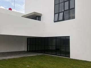 TERRAZA  /  LOFT CHIMALPOPOCA: Terrazas de estilo  por Arq. Jesus Sanchez G