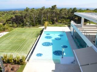 Albercas de jardín de estilo  por MJARC - Arquitectos Associados, lda