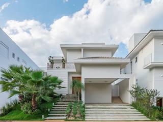 Casas em Montes Claros: Casas  por Ivan Araújo Fotografia de Arquitetura,Moderno