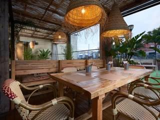 Nhà hàng theo MisterWils - Importadores de Mobiliario y departamento de Proyectos., Nhiệt đới