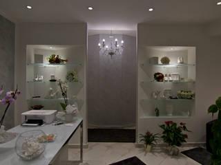 Le spose di Laura, non chiamatelo semplicemente Atelier! Pareti & Pavimenti in stile moderno di Marco Maria Statella - Architect Moderno