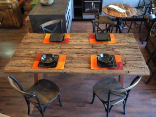 Tavoli industrial legno e ferro: Soggiorno in stile  di nuovimondi di Flli Unia snc