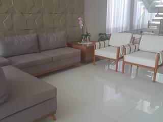 Sala de Estar - Conforto e Sofisticação juntos nesse projeto. por Ajala Arte Comercio de móveis e decorações ltda Clássico