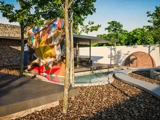 CASA SÁASIL KIIN  ( CASA QUE SALUDA AL SOL ): Jardines de estilo  por PERCEPTO ARQUITECTURA