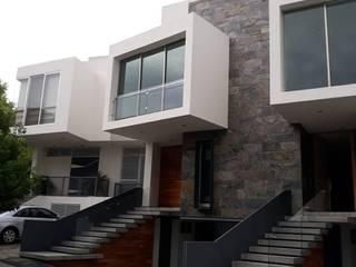 Acabados de interiores y exteriores en casa en Prados del Campestre, Casas modernas de SPACIOVIVO Moderno