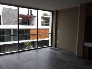 Acabados de interiores y exteriores en casa en Prados del Campestre,: Recámaras pequeñas de estilo  por SPACIOVIVO