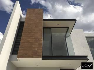 Casa Müst: Casas unifamiliares de estilo  por FFélix Architecture
