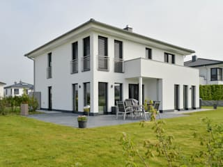 Stadtvilla aus Massivholz von Herrmann Massivholzhaus GmbH Modern