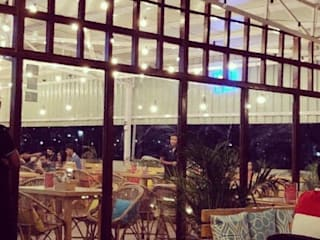Roof top cafe in Bangalore:  Hotels by Studio . abhilashnarayan