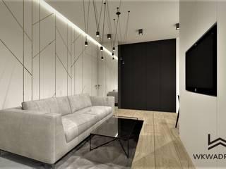 Mieszkanie w Warszawie Wkwadrat Architekt Wnętrz Toruń Minimalistyczny salon Drewno Biały