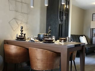 Dining room by TRASSO ATELIER