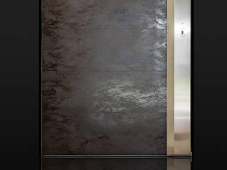 Bilico in grès: Porte d'ingresso in stile  di Ercole Srl
