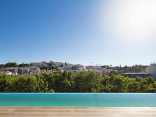 LIBERDADE 40: Piscinas infinitas  por Contacto Atlântico - Arquitectura,