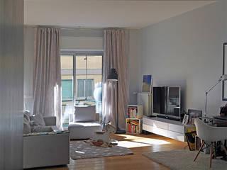 ZERO.4_ Una casa a portata di famiglia Soggiorno moderno di Giulia Grillo Architetto Moderno