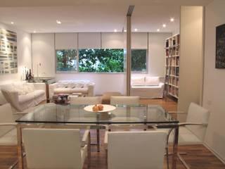 Modern dining room by Viviane Cunha Arquitectura Modern