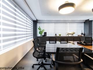 Escritório de advocacia: Espaços comerciais  por CG arquitetura e interiores,Moderno