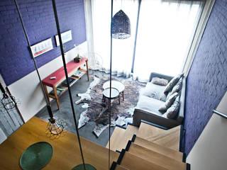 Reforma de un loft: Livings de estilo  por Ba75 Atelier de Arquitectura