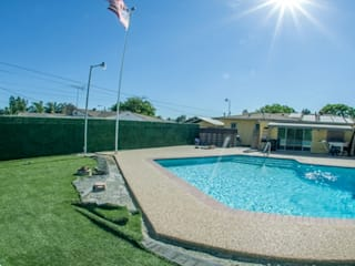 Swimming pool fence privacy artificial boxwood hedge:   by Sunwing Industries Ltd