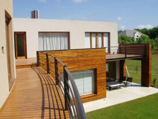 Casa en Grand Bell Casas modernas: Ideas, imágenes y decoración de Koch Garat Moderno