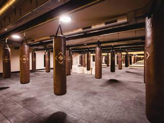 Proyecto de reforma, interiorismo, decoración y rehabilitación de gimnasio exclusivo en Valladolid Bares y clubs de estilo industrial de MEDITERRANEAN FUSION S.L. Industrial