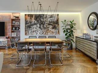 Proyecto de reforma integral, interiorismo y decoración de amplia vivienda en Valladolid Comedores de estilo ecléctico de MEDITERRANEAN FUSION S.L. Ecléctico