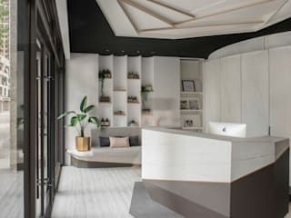 大理石牆紋讓純白多些點綴:  辦公空間與店舖 by 漢玥室內設計