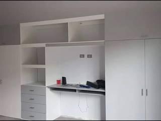 Diseño y Fabricación de Closets Decórame diseño más interiorismo Vestidores y closetsAlmacenamiento