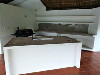 CUBIERTA DE GRANITO PARA COCINA DE AREAS COMUNES DE FRACCIONAMIENTO EN NUEVO VALLARTA STONE Tops & Decor Cocinas tropicales Granito