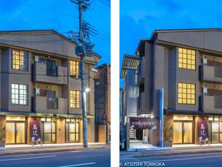 ビルの目の前に電柱のあるマンション外観を撮影、電柱及び電線を消しました。: 富岡写真事務所が手掛けたです。,