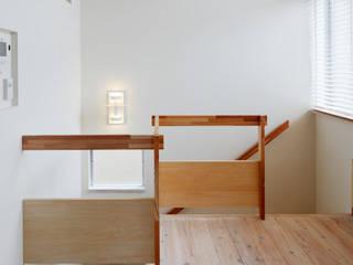 ふたりとにひきの家: 一級建築士事務所あとりえが手掛けた階段です。