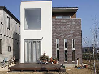 チョコレートタイルの家: 一級建築士事務所あとりえが手掛けた家です。
