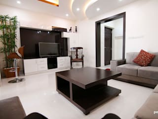 Flat at Shobha Forest Cedar, South Bangalore:  Living room by Pencil Interiors,