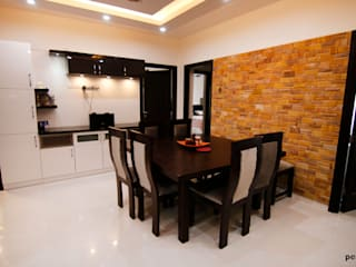 Flat at Shobha Forest Cedar, South Bangalore:  Dining room by Pencil Interiors,