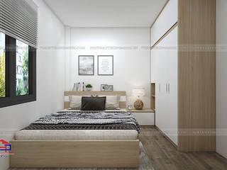 Công trình tủ bếp laminate và nội thất phòng ngủ gỗ melamine nhà chị Vân - La Phù, Hoài Đức Nội thất Hpro BedroomBeds & headboards Multicolored