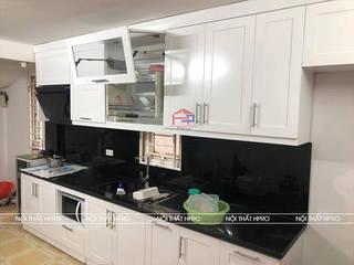 Công trình tủ bếp MDF lõi xanh sơn trắng nhà anh Hiệp – Ngõ Tức Mặc Trần Hưng Đạo: hiện đại  by Nội thất Hpro, Hiện đại