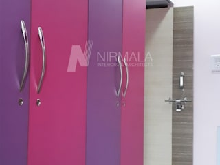 Nirmala Architects & Interiors BedroomWardrobes & closets