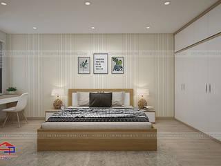 Công trình tủ bếp gỗ sồi nga và nội thất gỗ công nghiệp An Cường nhà anh Long - 62 Nguyễn Đức Cảnh Nội thất Hpro BedroomBeds & headboards Multicolored