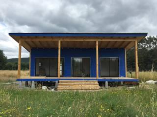 Cabaña Rio Calle Calle, Antilhue Casas modernas: Ideas, imágenes y decoración de Constructora Crowdproject Moderno