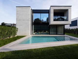 PRÊT - À - HABITER Mino Caggiula Architects Giardino con piscina