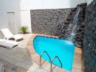 Garden Pool by INNOVACIONES FOURIER S DE RL DE CV , Minimalist Concrete