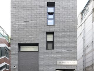 Projekty,  Dom wielorodzinny zaprojektowane przez 주택설계전문 디자인그룹 홈스타일토토, Nowoczesny
