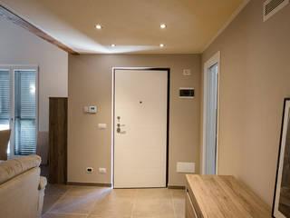 Pasillos, vestíbulos y escaleras minimalistas de Building Evolution Minimalista